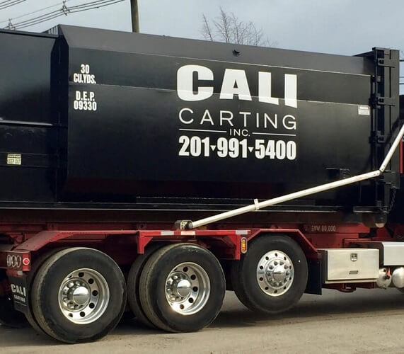black cali carting truck compressed